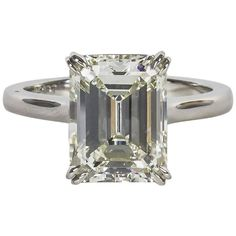Elegant 4.26 Carat GIA Cert Emerald Cut Diamond Solitaire Engagement Ring | From a unique collection of vintage engagement rings at https://www.1stdibs.com/jewelry/rings/engagement-rings/