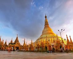 Since its been a while here's a 2nd post for today from #Myanmar . This is the Shwedagon Pagoda that towers over #Yangon . As #sunset approached more people arrived to see the golden stupa in all its glory. This is when I left to race across the city in terrible traffic to capture a reflection of the #pagoda in Kandawagyi Lake. So is the life of a travel blogger with limited time.