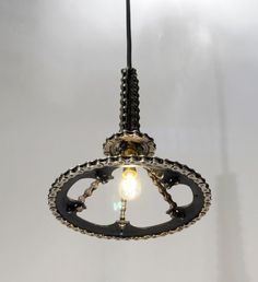 Lighting fixtures made with bike parts are a creative way to help save the planet part Green Ideas to Recycle Bike Parts for Unique Lighting Fixtures Car Part Furniture, Automotive Furniture, Automotive Decor, Metal Furniture, Diy Luminaire, Luminaire Design, Lampe Steampunk, Recycled Bike Parts, Bike Craft