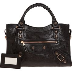 Balenciaga....I remember about 6 or 7 yrs ago when this one came out...Kate Moss & Lindsey Lohan were carrying them.  Love!