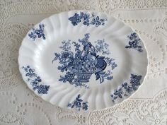 This is a lovely vintage Myott & Son Staffordshire England Bountiful Blue Platter. This platter measures about 12 inches across and 9.5 inches from top to bottom. The pattern features a blue fruit basket with a swirled scalloped edge. The plate is in good condition without chips, cracks or crazing however there are some minor color imperfections, which are very small. You can see them in the 3rd and 4th pictures. This would be perfect to use as a serving platter or would look just as lov...