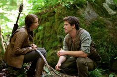 Jennifer Lawrence as Katniss Everdeen and Liam Hemsworth as Gale Hawthorne in The Hunger Games.