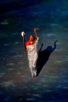Maria Sharapova carries the Olympic torch into the stadium during the Opening Ceremony of the Sochi 2014 Winter Olympics at Fisht Olympic St...