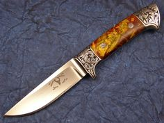A very nice Full Integral knife by Edmund Davidson. Engraved by Jere Davidson. This knife was featured on one of David Darom's books. Edmund is one of the top 3 Integral knife makers. Blade Length: 4 1⁄4 inches; Overall Length: 8 3⁄4 inches; Blade Steel: 440-C Stainless Steel; Handle Material: Stabilized Box Elder Wood Guard Material: 440-C Stainless Steel