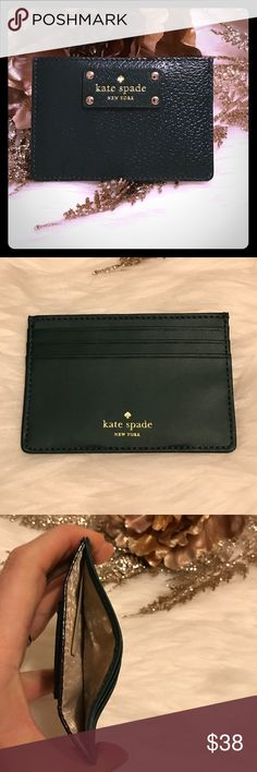 Kate Spade Card Holder 💳 This is a brand new with tags item. It is a leather card holder that has 3 card slots and a bigger pocket to store more cards or cash. It is a rich forest green color. kate spade Bags