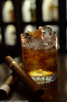 Old Fashioned- Bourbon, Angostura Bitters, lump of sugar. Garnish with orange rind.    http://www.asia-bars.com/2012/12/arthurs-bar-grill-at-shangri-la-hotel-kuala-lumpur/