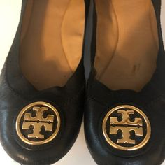 Tory Burch Ballet Flats - 6M. The inside of the shoes have no issues but there is wear on the exterior.