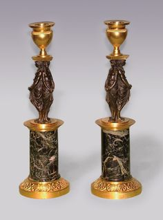 A Pair of early 19th Century bronze and ormolu Candlesticks having vase-shaped sconces above unusual triple classical lady stems raised on green marble columns ending on leaf decorated circular bases. (Previously wired for electricity.) Circa: 1800 Ref: 5670