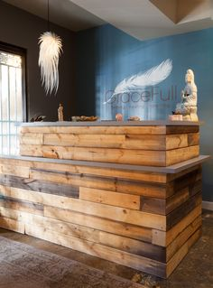 The reclaimed wood reception area designed by Rosa Beltran Design at Gracefull Birthing in Silverlake, Los Angeles.  It's a fabulous resource for natural pregnancy care and childbirth and I'm so happy to have been a part of it.  Not only did I have my own child with Gracefull Birthing, but then I joined their team to design their new LA birth center as well! gracefull.com