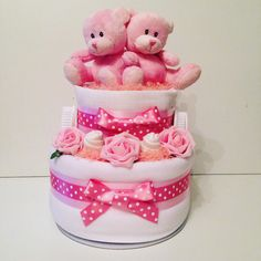 Cute twin girls nappy cake includes two of each item available at www.cheshirenappycakes.co.uk #baby #babygift #babyshower #babyshoweridea #nappycake #diapercake #twins