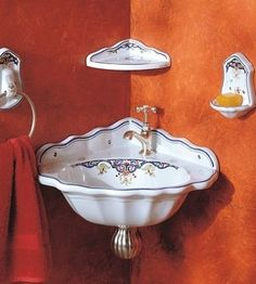 'Neptune' washbasin, towel ring and soap dish in Vieux Rouen handpaint is proportioned for smaller bath and powder rooms.