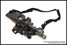 FN Herstil  P90 is a PDW personal defense weapon. The 90 comes from the year it was placed into production. It fires the 5.7X28mm round and has a 50 rd transparent mag that sit on top of and flush with the weapon, below the sights.  It was made to be partnered up with the FN H 57 pistol.