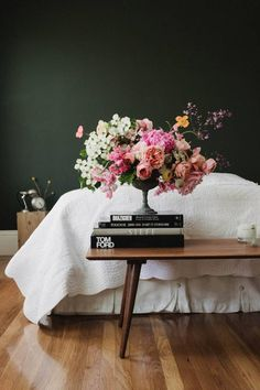 in the category dark walls that aren't grey.. probably love the flowers most of all but it works