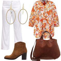 Decisamente in tema autunnale la tunica, sia nel disegno che nei colori, abbinata ad un paio di pantaloni bianchi. Le scarpe e la borsa sono nei toni del marrone e un paio di orecchini completano l'outfit.