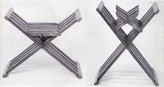Small x-chair made from walnut in seating and folding position. The folded image clearly shows the construction of the chair with the four (iron) pins though the laths. Pins for this chair type can also be wooden dowels. Museum fur Angewandte Kunst, Vienna, Austria. height 49 cm, width 63 cm and depth 35 cm. Image from the book Mobel Europas I -Romanik - Gotik by G. Windisch-Graetz.