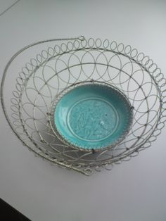 Old fruit bowl, china and metal wire.