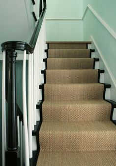#blackandwhite banister and natural fiber runner