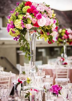 Featured Photographer: True Photography Weddings; Pretty in pink floral wedding reception centerpiece
