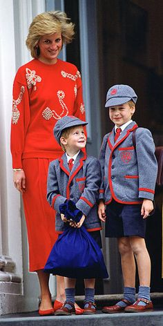 Princess Diana with Prince William and Prince Harry in little uniforms when they were young.