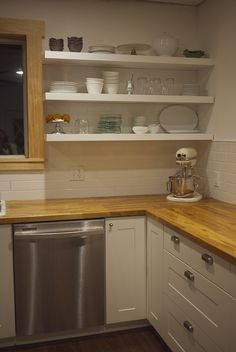 Open shelving, white cabinets, stainless appliances, wood counters, subway tile... Le sigh.