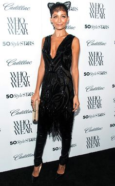A Cats Meow from Nicole Richie's Best Looks  The designer wore a Dilek Hanif Couture black cocktail dress over Robin's Jean leather pants. She accessorized her look with Louboutin pumps, Maison Michel lace cat ears and her own House of Harlow clutch and ring.