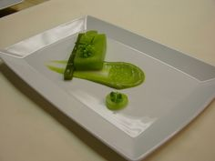 Compressed cucumber and honeydew, baby fennel puree, honeydew caviar tossed in mint oil, brunoise fava beans, spring pea puree (under the brunoise fava in a parisenne cut out of the honeydew, micro mint and chervil.