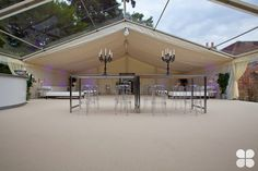 Clear roof section seamlessly transitions into ivory starcloth within a party tent.