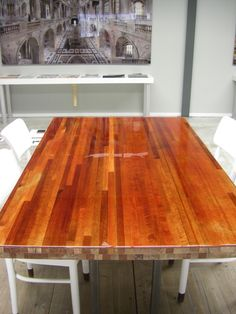 Customized tabletop made from leveled wood and moulded with Hermes Orange colour coating