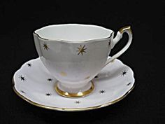 Beautiful vintage tea cup and saucer, made by Queen Anne from bone china, England,Depicting gold stars!