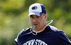 PENN STATE – FOOTBALL 2013 – Penn State head coach Bill O'Brien coaches during the team's NCAA college football practice on Friday, Aug. 16, 2013, in State College, Pa.