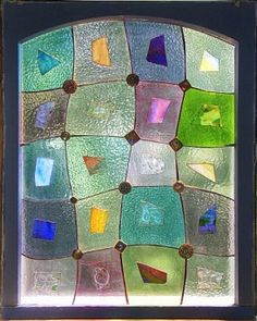 I love quilts and stained glass.  Alison incorporates both in this stunning window.
