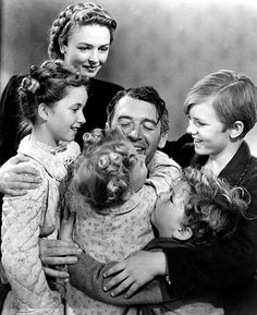It's a Wonderful Life (the man is at the centre of the family whilst the wife looks almost like an outsider)