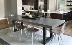 White top with metal legs. Custom Concrete Kitchen & Dining Tables - Trueform