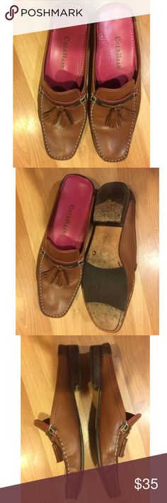 Cole Haan clogs/mules Tassel slip-on  size 7AA You are looking at a Women's ColeHaan clogs Mules,Tassle slip-ons Brown leather size 7AA  Very good used condition.and from our smoke free home. Cole Haan Shoes Mules & Clogs