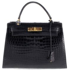 Pre-owned Kelly Bag made of crocodile leather (£14,485) ❤ liked on Polyvore featuring bags, black, preowned bags, crocodile skin bag, heart bag, crocodile leather bag and lock bag