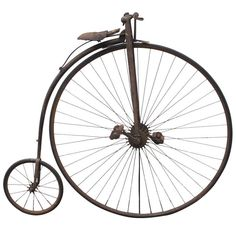 1879 High Wheel Bicycle Culture: American Turned wood hand grips, leather seat covering, and rubber tires and peddle rests. Mounted to be freestanding as a sculpture on a black metal base. The bicycle is accompanied by a book The American Bicycler by Charles E. Pratt issued by The Pope Manufacturing Co, Boston, Mass. printed in 1879 and picturing a similar bike. A metal tag near the handlebars lists patents from 1864 to 1878.