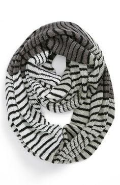 This is the rare type of scarf that I am ok with: thin, not bulky, long, neutral stripes