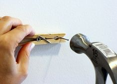 Always accidentally hammering your fingers? Use a clothespin to help you hammer the nail safely into where you need it to be.