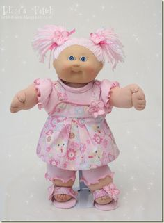 Pixie Dust Scented Custom Cabbage Patch Reroot with Pink and White Double Pom-Poms, a stretch knit t-shirt and leggins with lettuce edging, and cute sparkly romper, and matching sandals. Cabbage Patch Kids Clothes, Cabbage Patch Kids Dolls, Baby Doll Clothes, Baby Dolls, Santa Outfit, Yellow Floral Dress, Doll Crafts, Kids Crafts, Kids Patterns