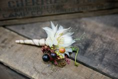 Delicate boutonniere with berries by Waterlily Pond.