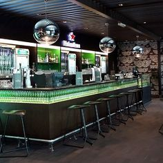 Heineken Airport Lounge opens in Dubai - Business Traveller - Coffee In Dubai, Dubai Hotel, Airport Architecture, Beer Bottle Crafts, Gaming Lounge, Wooden Bar Table, Dubai Business, Italian Cafe, Airport Lounge