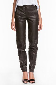 This smooth-as-butter Halston Heritage Slouchy Leather Trouser puts a modern spin on a staple silhouette. Composed of 100% lambskin, this tapered pant features a relaxed fit with on-seam pockets that detail the hips, a tonal-elastic waistband, and detail stitching for a tailored finish  http://www.isaay.com/Halston-Heritage-Slouchy-Leather-Trousers/HAL-104132,default,pd.html?dwvar_HAL-104132_color=EAR=8=winter_essentials=Price%20%28High%20to%20Low%29