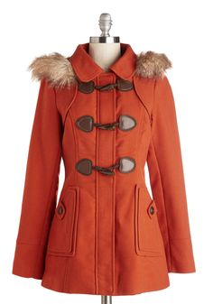 Harvest Fest Coat. Whether youre weaving your way through a corn maze or picking out the perfect pumpkin from the patch, this cinnamon-hued toggle coat will keep you cozy while you celebrate the season. #orange #modcloth