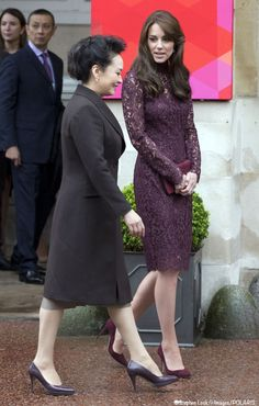 oct 21/wi. Chinas 1st lady HIT&MISS: i like this color on kate but color and fabric both make this seem evening. Also she should have left that purse at home. and all that hair?  mainly a miss