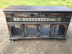 I repurposed this old dresser into a rustic dog kennel. It's painted with Van Gogh fossil paint and sealed with wipe on poly.