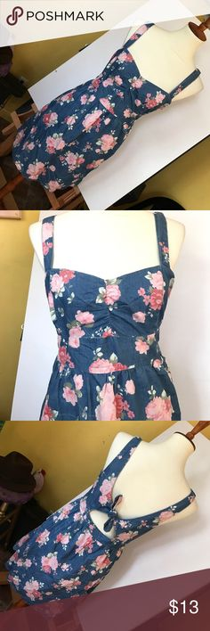 Denim Floral Cut Out Back Dress Cute denim dress with pink floral rose print. The back is even cuter with an open cut out tie. Side zipper and pockets!!!! Worn a few times, great condition, haven't seen any flaws! Forever 21 Dresses