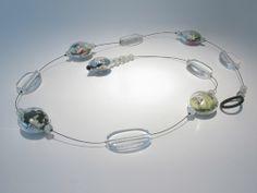"Marianne Kohler - ""Necklace,"" blown borosilicate glass, comics, jade, crystal, steel wire"