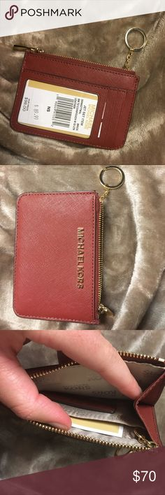 Michael Kors card case Jet set small coin pouch with ID slot. I bought this thinking it was the smaller one, but it's the larger one. Gold hardware and plum color.  First picture is most accurate for color! NWT. Michael Kors Accessories Key & Card Holders