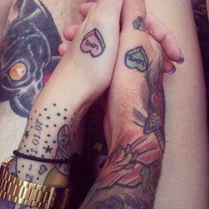 Matching couple tattoos.