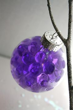 DIY Christmas Ornaments ~~ Fill a clear ornament with water beads. You can find these beads at the dollar store.